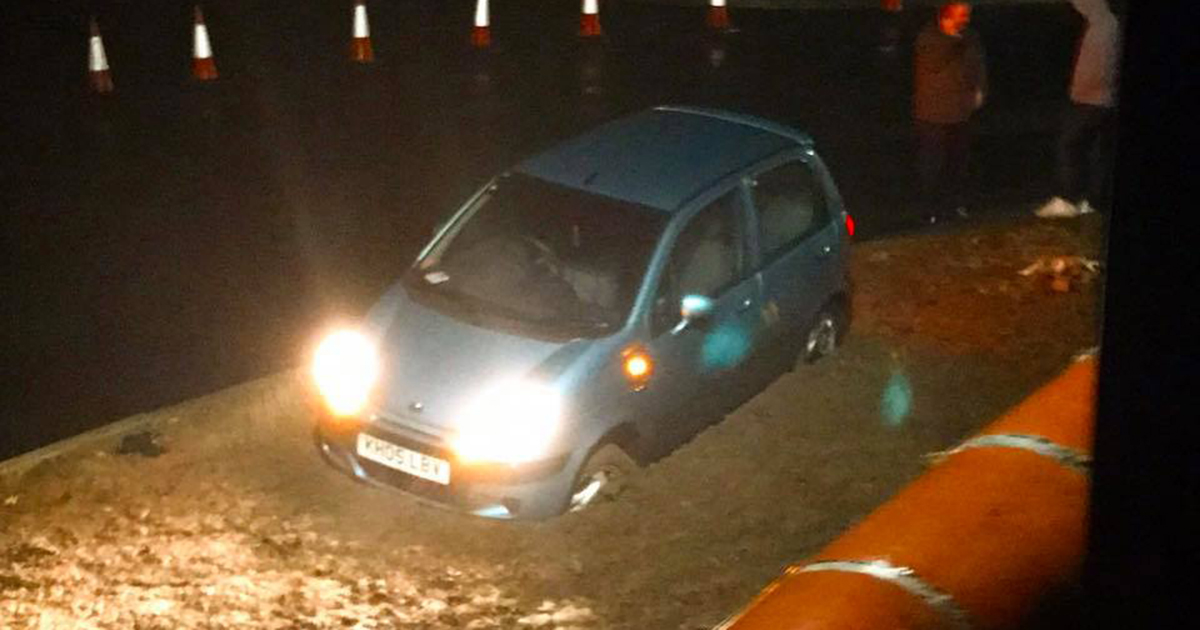 A mixed-up driver was left stuck in the road - after trying to drive through wet cement.