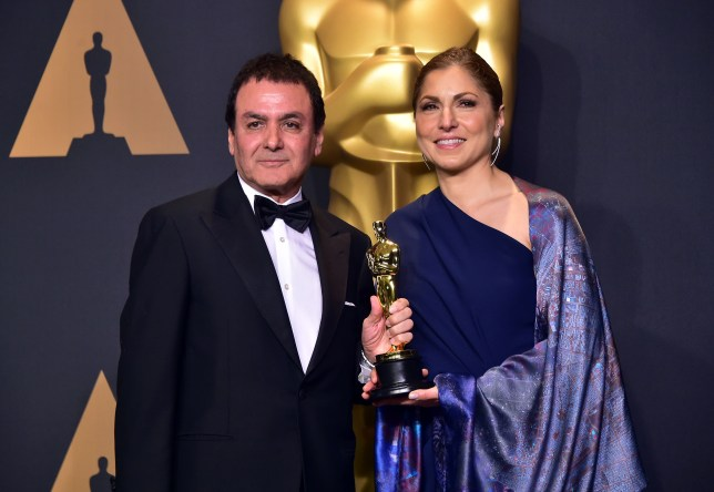 Former NASA scientist Firouz Naderi (L) and engineer/astronaut Anousheh Ansari pose with the Best Foreign Language Film award for 'The Salesman' on behalf of director Asghar Farhadi in the press room during the 89th Oscars on February 26, 2017, in Hollywood, California. / AFP PHOTO / FREDERIC J. BROWNFREDERIC J. BROWN/AFP/Getty Images