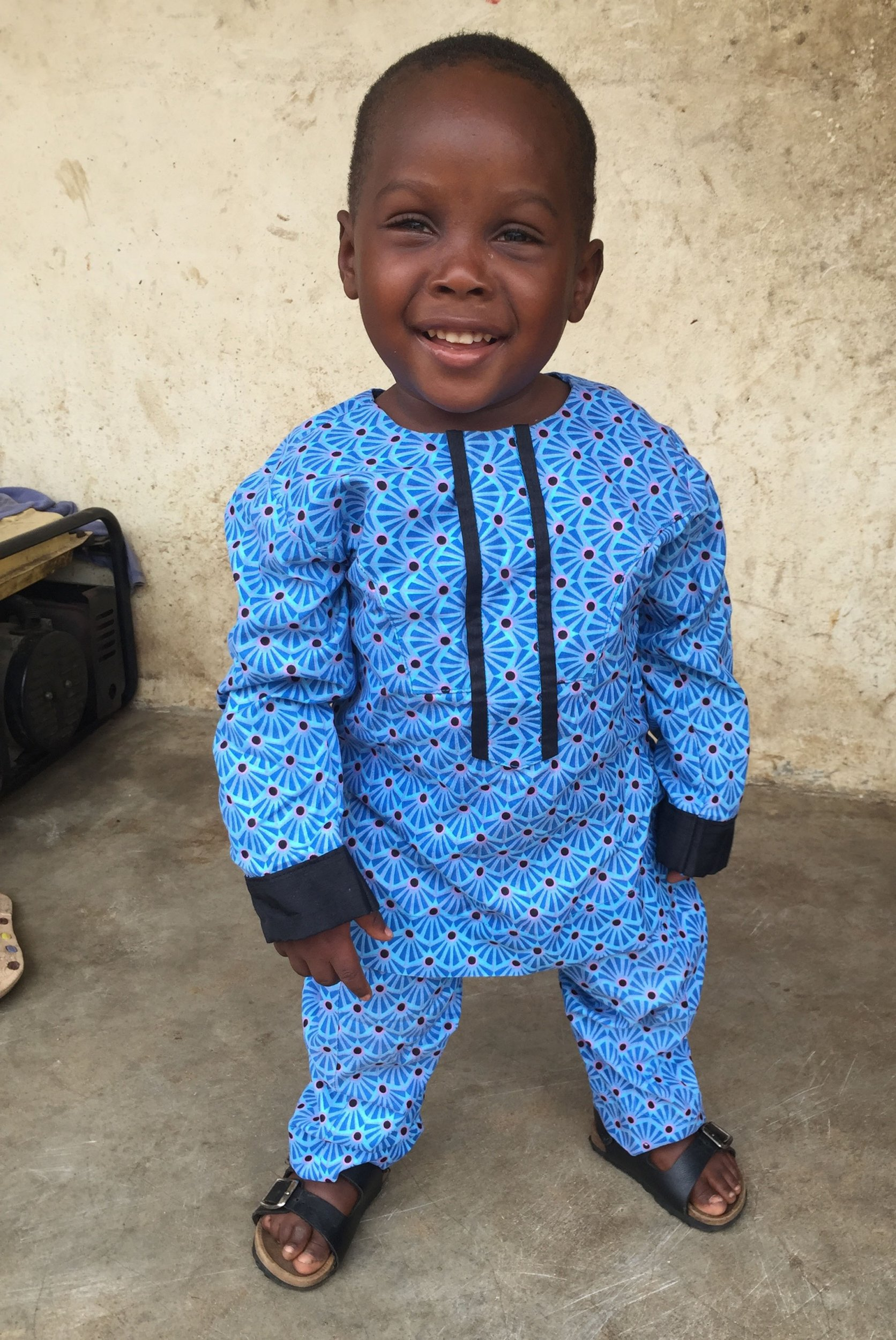 """""""Witch boy"""" first day of school Incredible recovery of the Nigerian 'witch child' who was left for dead by his parents: Care worker reveals pictures of fighting fit two-year-old after heart-breaking image shocked the world"""