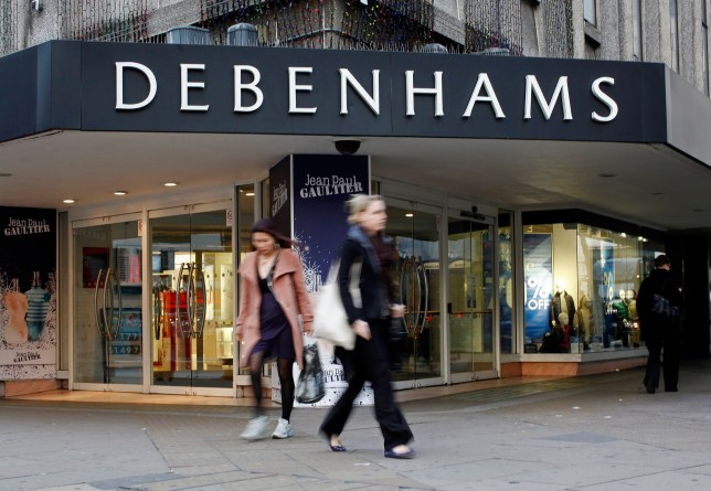 Pedestrians pass the entrance to a Debenhams store on Oxford Street in London, U.K., on Tuesday, Jan. 10, 2012. Debenhams Plc, the U.K.'s second-largest department-store chain, rose the most in more than 2 1/2 years in London trading after holiday sales beat estimates and the retailer said it expects commodity-cost pressure to ease. Photographer: Simon Dawson/Bloomberg via Getty Images