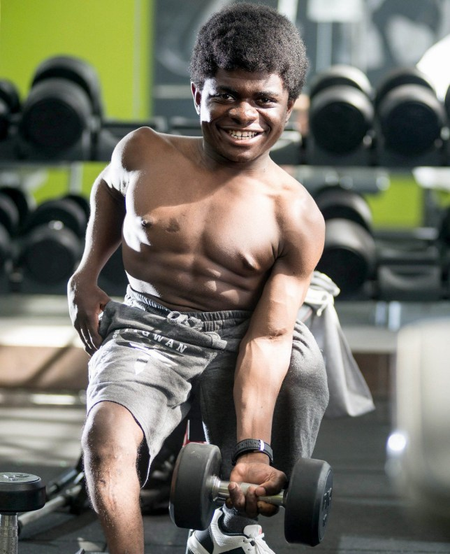 PIC FROM Caters News - (PICTURED: Caleb Mutombo training) - Meet Caleb Mutombo who at just 3 foot 7inches is hoping to take the bodybuilding world by storm. With a rippling six pack and bulging biceps its hard to believe Caleb, 19, weighs just 5 stone 8lbs. He trains at his local gym in Johannesburg five days a week, where he can squat 30kg and lift 10kg. Originally from the Congo, Caleb suffers from an undiagnosed disability which meant he grew at a rate much slower than the average person and stopped growing altogether when he was just 14. Born in the Congo, Caleb began weight training at home when he was 12, lifting anything he could get his hands on from coffee tables to bags of books. SEE CATERS COPY.