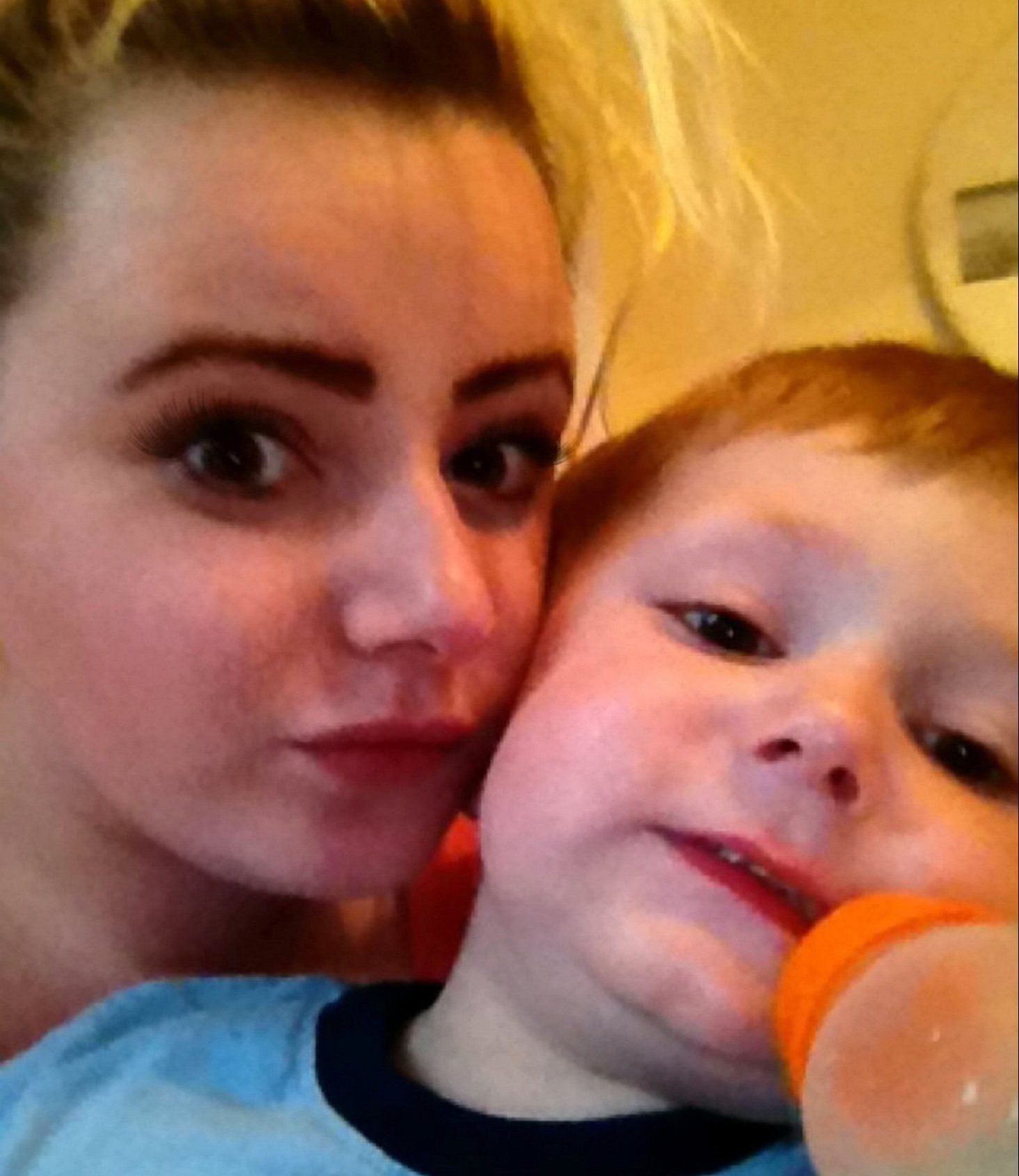 Sophie Brown with her son Riley Apps. See Ross Parry story RPYEGG; A mother has told of her horror after her son opened a chocolate egg expecting to find a toy inside - but discovered six TABLETS. Little Riley Apps, two, had enjoyed the Minions-themed treat and was struggling to open the plastic container which usually contains a toy, so took it to his mum Sophie Brown, 22. But she was horrified when she found four colourful capsules and two white tablets marked with 'MDZ' - suspected to be palliative care sedatives.