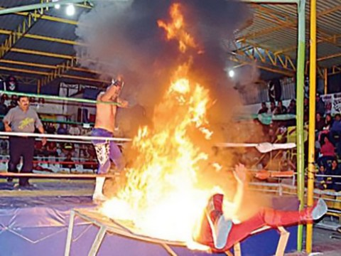 Wrestler suffers third-degree burns after opponent slams him into burning table