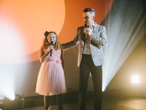 Watch Robbie Williams surprise a life-long fan with the help of her daughter