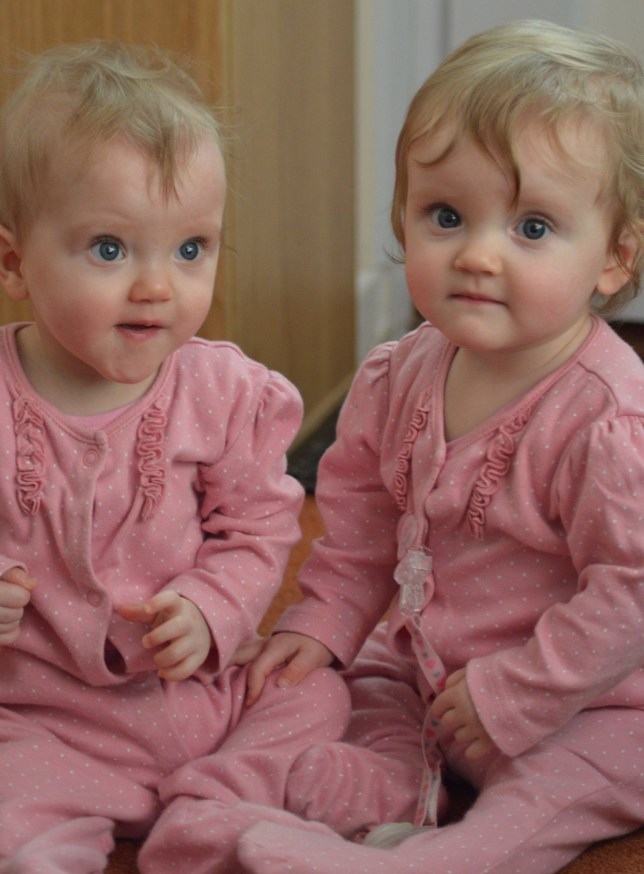 Twins Leah and Erin on their first birthday. (Pictures: SWNS)