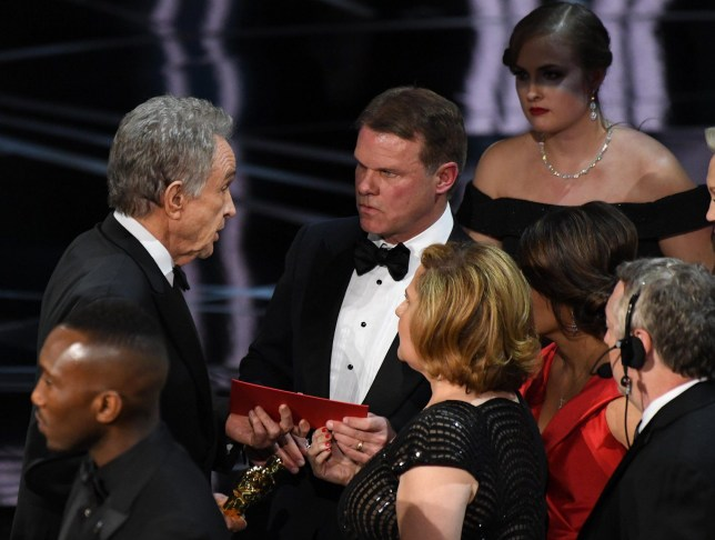 Mandatory Credit: Photo by ddp USA/REX/Shutterstock (8436379hc) Warren Beatty speaks to Brian Cullinan, a CPA from Price Waterhouse Coopers for the Oscars 89th Annual Academy Awards, Show, Los Angeles, USA - 26 Feb 2017
