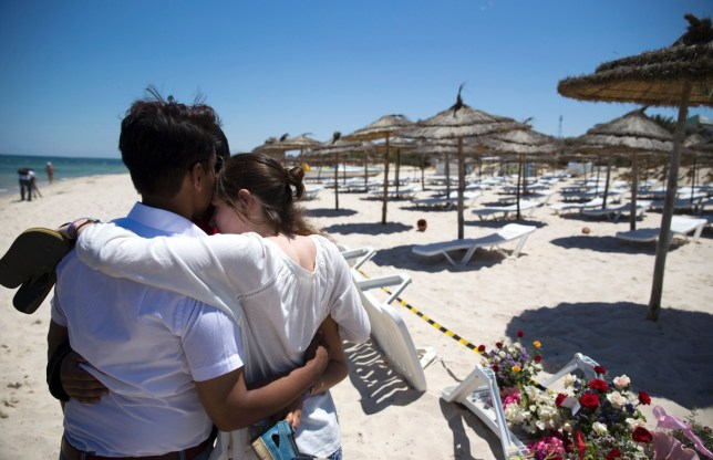 (FILES) This file photo taken on June 27, 2015 shows a couple standing at the site of a shooting attack on the beach in front of the Riu Imperial Marhaba Hotel in Port el Kantaoui, on the outskirts of Sousse. The coroner at the inquest into the deaths of 30 Britons killed by an extremist gunman in Tunisia is to deliver his conclusions on February 28, 2017. / AFP PHOTO / KENZO TRIBOUILLARD AND -KENZO TRIBOUILLARD/AFP/Getty Images
