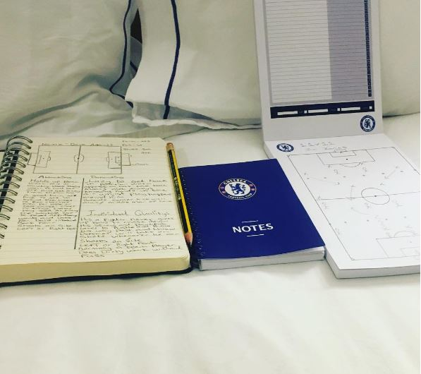 True Blue! Ashley Cole uses Chelsea branded stationary for his homework