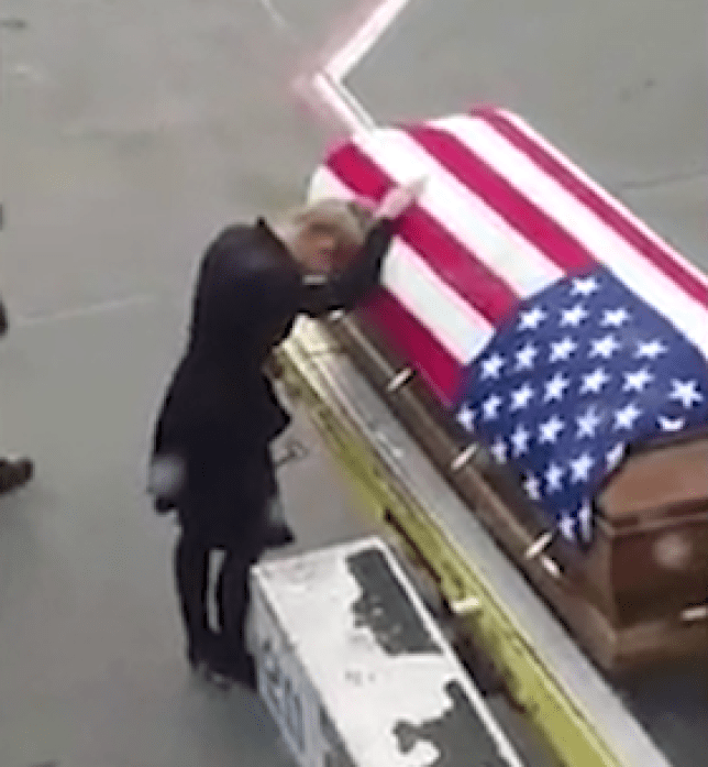 Young widow meets her military husband's coffin on runway in
