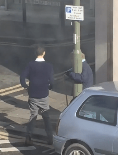 An estate agent was filmed helping an elderly woman home (Pictures: Jodie Lynch)