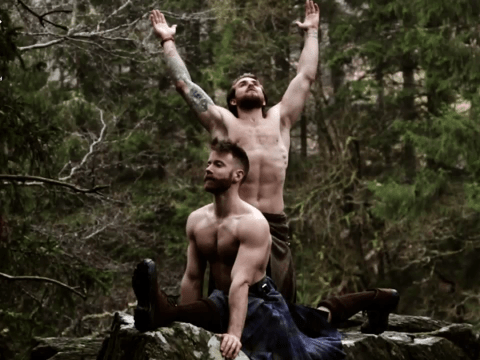 These dudes are doing downward dog in nothing but kilts and it's inspiring people to get moving