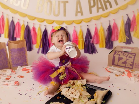 We can all relate to how happy this one-year-old is to be posing with tacos