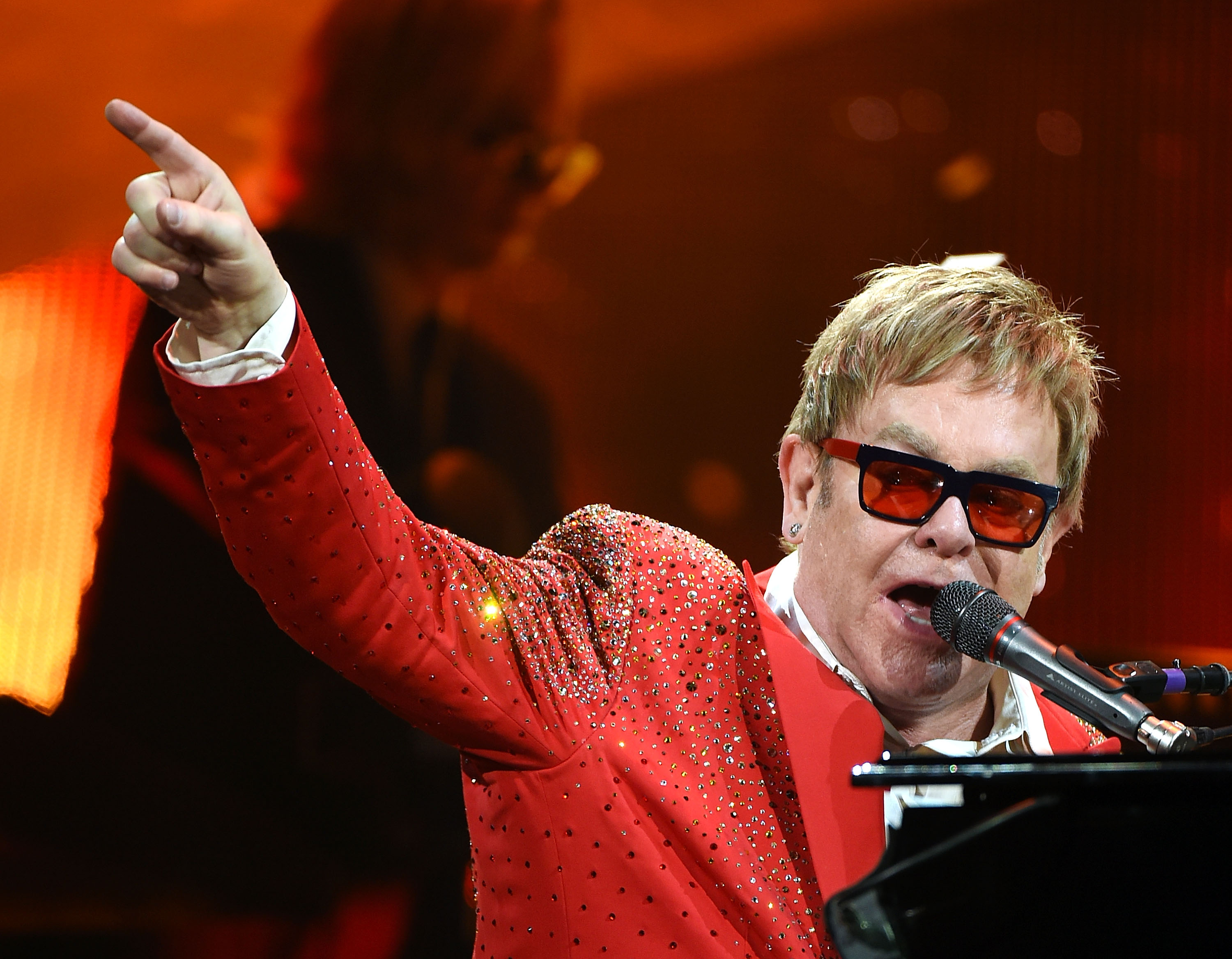 Sir Elton John says he will make a decision about retiring from touring 'within six months'