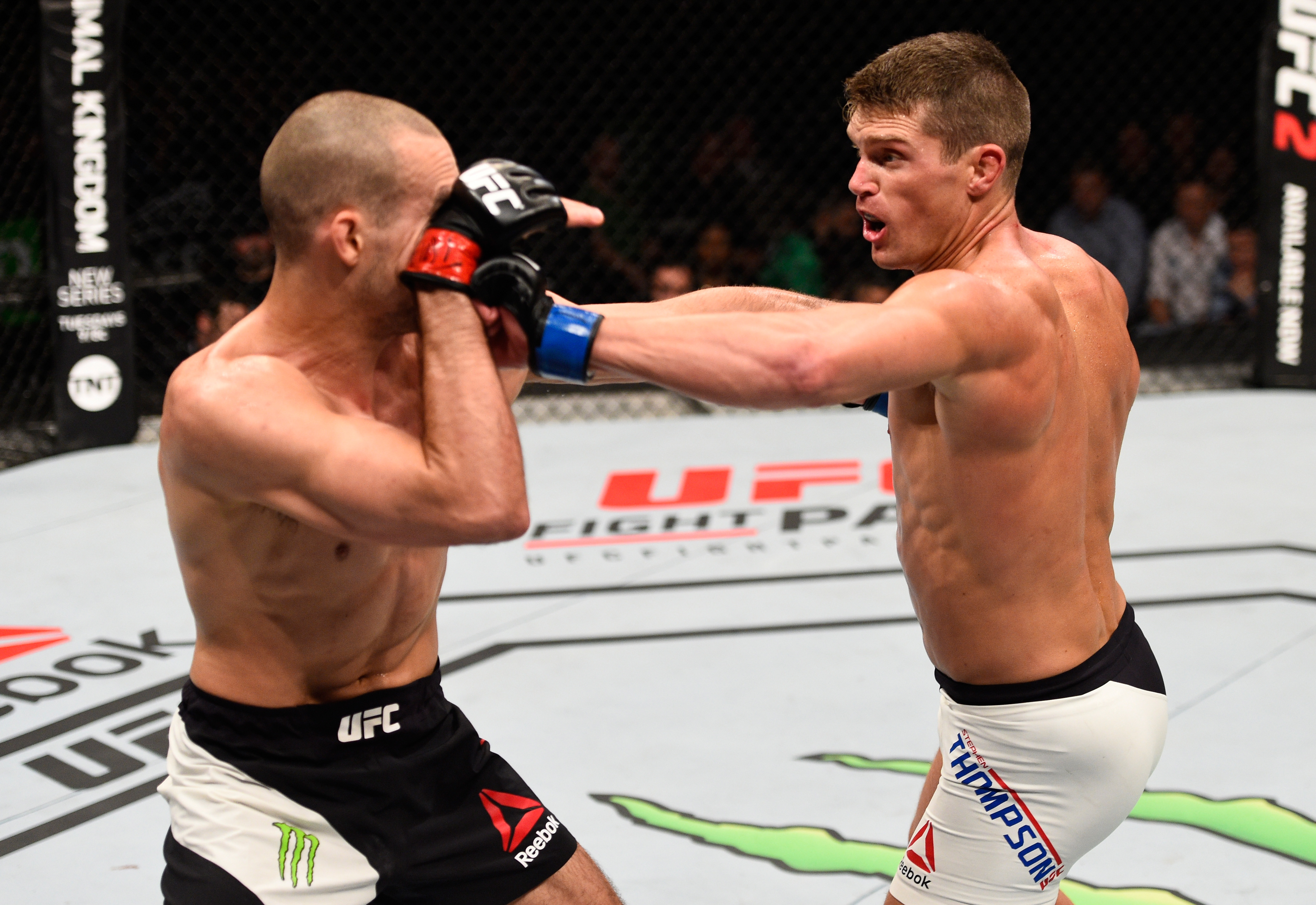 OTTAWA, ON - JUNE 18: (R-L) Stephen Thompson of the United States punches Rory MacDonald of Canada in their welterweight bout during the UFC Fight Night event inside the TD Place Arena on June 18, 2016 in Ottawa, Ontario, Canada. (Photo by Jeff Bottari/Zuffa LLC/Zuffa LLC via Getty Images)