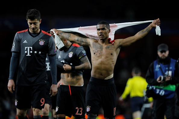 Chelsea star Willian celebrates Arsenal's 10-2 humiliation with Bayern Munich ace Douglas Costa