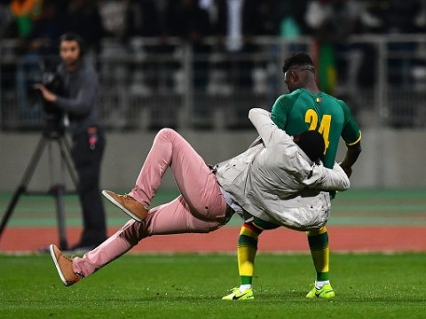 Man Utd and Liverpool stars caught up in shocking pitch invasion during Ivory Coast v Senegal