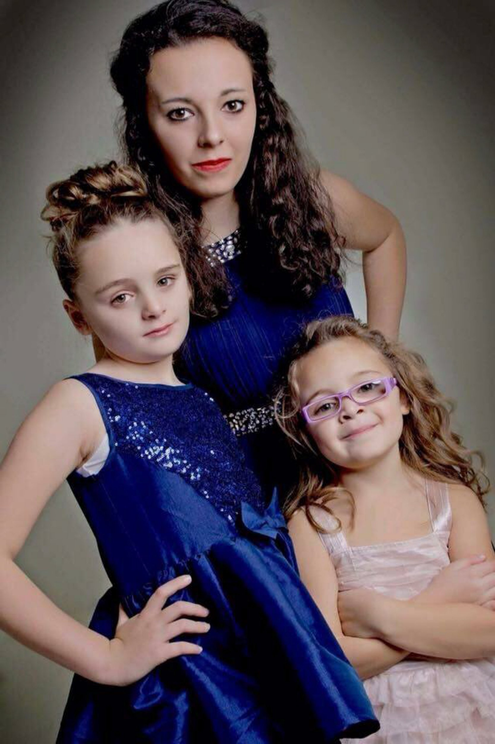 PIC FROM MERCURY PRESS (PICTURED: L-R MILLIE-GRACE ATKINSON, 12, MUM GILL TURNER, 47, AND FINTY ATKINSON) A mum has claims a fellow PARENT at her childís school sent her 12-year-old autistic daughter a string of RACIST and threatening messages after the two girls had a row on the way home. Gill Turner, 47, claims she was only alerted to the situation when her daughter Millie-Grace asked if it was ëever OK for a man to call someone a n****r?í. Immediately concerned, the mum-of-three took her daughter's phone and discovered a series of texts sent by Dean Sheridan ñ containing racist abuse and threats of violence. SEE MERCURY COPY