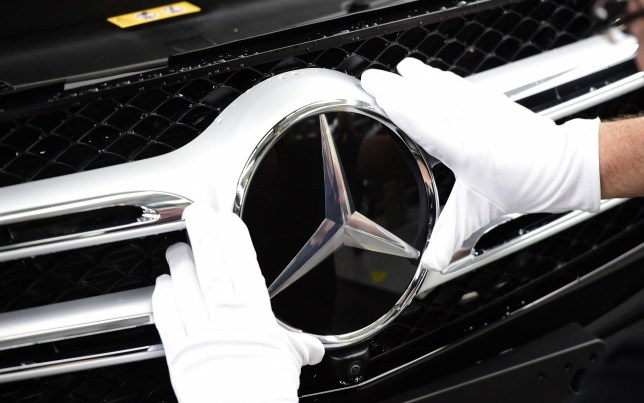 FILE Daimler Recall 75,000 Mercedes-Benz Cars In UK BREMEN, GERMANY - JANUARY 24: The emblem of a Mercedes-Benz of C-Class car is pictured on the assembly line of Mercedes-Benz on January 24, 2017 in Bremen, Germany. Daimler AG, which owns Mercedes, is scheduled to present its financial results for 2016 on February 2. Many German automakers are concerned over recent comments by U.S. President Donald Trump over possible tariffs on cars produced outside of the USA. (Photo by Alexander Koerner/Getty Images)