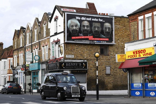 An anti-Brexit billboard errected by the stopthesilence campaign following a fund raising campaign is seen in London on March 4, 2017. Giant billboards showing a poster attacking the governments handling of Brexit have appeared in towns and cities across Britain after members of a Facebook group raised nearly 70,000 GBP in donations. / AFP PHOTO / Justin TALLISJUSTIN TALLIS/AFP/Getty Images