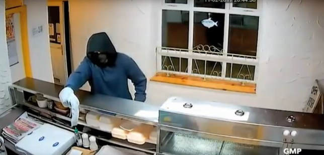 "Man tries to rob a fish and chip shop in Atherton, Greater Manchester with a banana. See SWNS copy SWBANANA: Police are a-peel-ing for help to catch a hapless crook who apparently tried to rob a fish and chip shop - with a BANANA. The masked raider burst into the takeaway and pointed the 'gun' at staff while he screamed ""open that f***ing till now"". But the makeshift weapon appears to be nothing more than a curved fruit concealed in a plastic bag. CCTV then shows him fumbling in his picket to try and pull out another weapon - but he fails and scarpered empty-handed."
