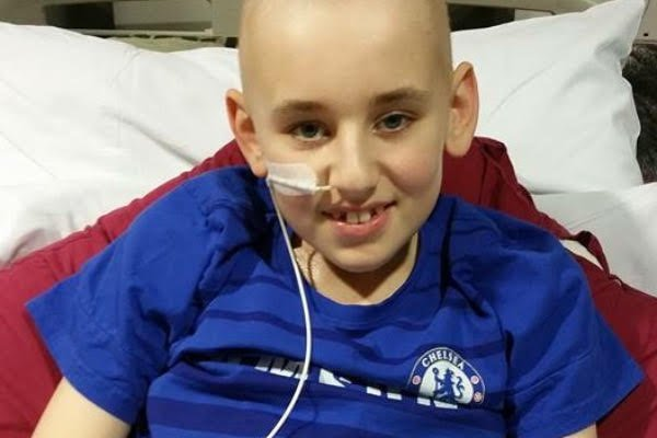 """Collect photo of Daryl Allinson, 13, from Frome, Somerset, when he was in hospital in Bristol during his first treatment for a super-rare cancer. See SWNS story SWRARE; A boy who was the only person in the world to suffer from a super-rare cancer has made a remarkable recovering thanks to crowdfunded treatment denied by the NHS. Daryl Allinson, 13, was struck down with a rare form of leukaemia in 2015 but went into remission thanks to a bone marrow transplant from his brother Bradley, 22. Tragically, the cancer came back and doctors said he needed a second bigger transplant ñ or would have just months to live. But NHS funding bosses ruled it would not pay for the £80,000 treatment and the family accused the service of """"leaving him to die"""". Kind-hearted strangers donated the entire cost and eight months on the teen is back at football training for the first time in years - and is due back in school this month. His mum Sam, 42, from Frome, Somerset, said: """"He's proving them wrong, those who made the decision there wasn't enough chance of success. """"He's always been so happy, always smiling, and he's still very determined."""