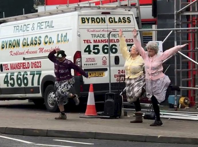 """A hilarious video showing three """"dancing grannies"""" performing to PSY's classic Gangnam Style on a busy high street in Nottingham has gone viral after it left shoppers in stitches. See NTI story NTIDANCE; Shoppers were stunned when the three dancers, dressed as old women, started performing their routine outside a Co-Operative Funeral Care building. Dozens of people rushed to take photos and video the bizarre group dance as they took Eastwood High Street in Nottingham by storm. One shopper, Joanna Henson, 37, uploaded an 82-second clip to Facebook and has already been viewed more than 65,000 times. In the video, shoppers can be heard bursting into laughter while they cheer on the grannies. One man is heard saying: """"That is brilliant. Only in Eastwood."""""""