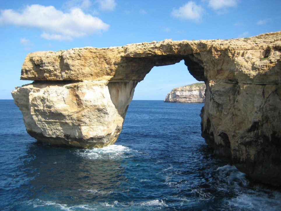 This is a April 2014 image of the landmark the Azure Window located just off Malta. The natural rock arch jutting off the Maltese island of Gozo, has collapsed into the sea during a storm. Maltaís prime minister called the loss on Wednesday March 8, 2017, of the iconic limestone formation ìheartbreaking.î No one was injured by the fallen arch, which was also a TV and film backdrop.(Caroline Hodgson via AP)