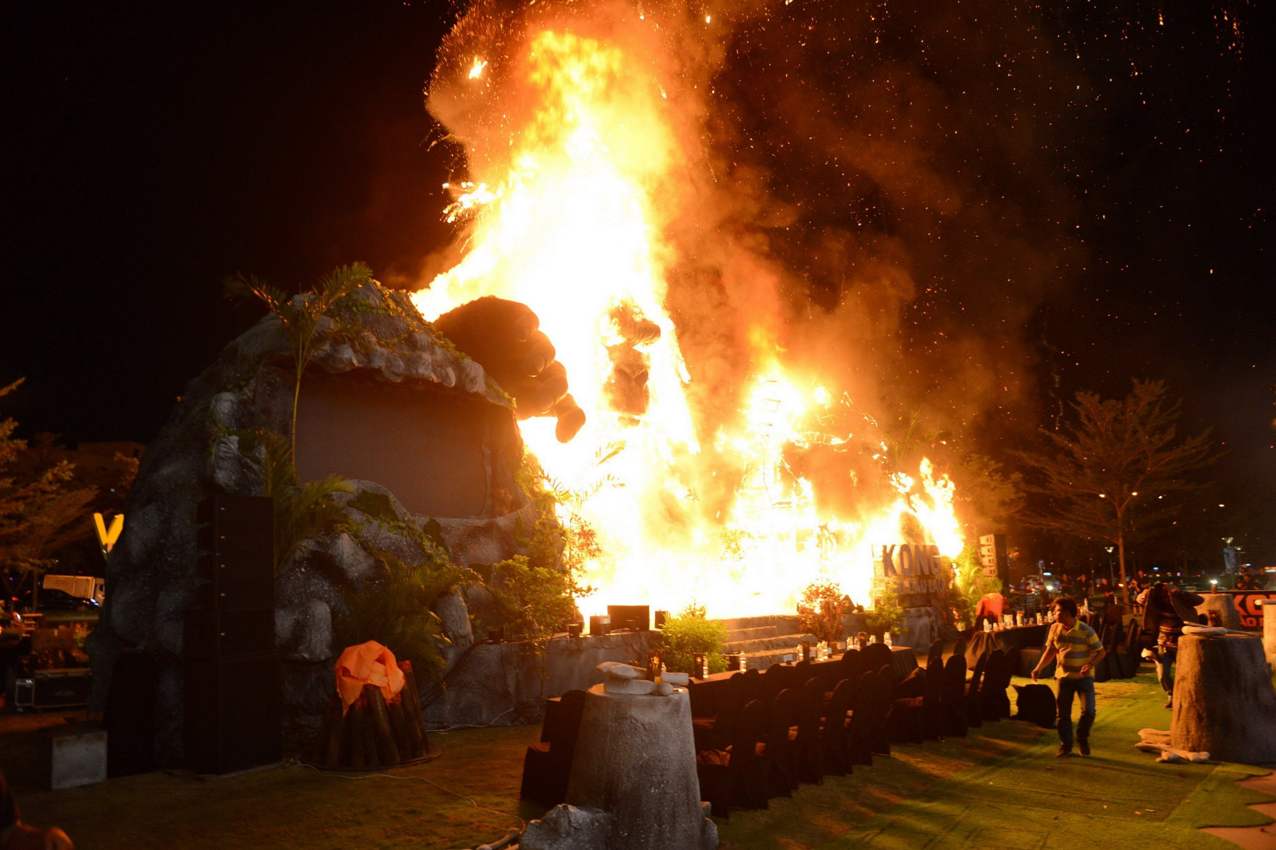 """This picture taken on March 9, 2017 shows a giant model of King Kong going up in flames during the premiere of the """"Kong: Skull Island"""" in Ho Chi Minh City. Film buffs with the hottest ticket in town were left running for safety after a giant model of King Kong went up in flames at the sizzling Vietnam premiere of the rebooted horror classic. / AFP PHOTO / STRSTR/AFP/Getty Images"""