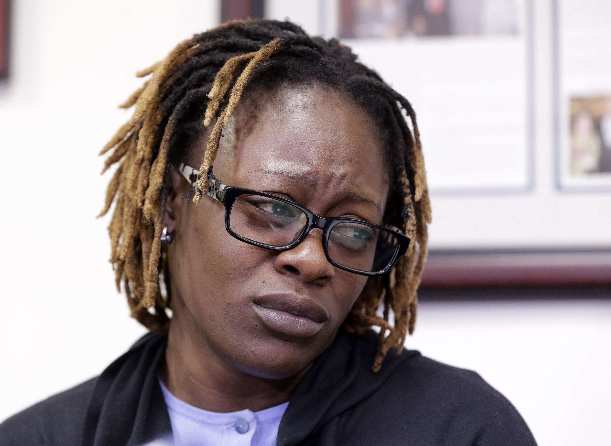 Gina Alexis, center, mother of 14-year-old Nakia Venant, who livestreamed her suicide on Facebook over the weekend, pauses as she talks about her daughter during a news conference, Wednesday, Jan. 25, 2017, in Plantation, Fla. Nakia Venant's suicide is at least the third to be livestreamed nationally in the last month. (AP Photo/Alan Diaz)