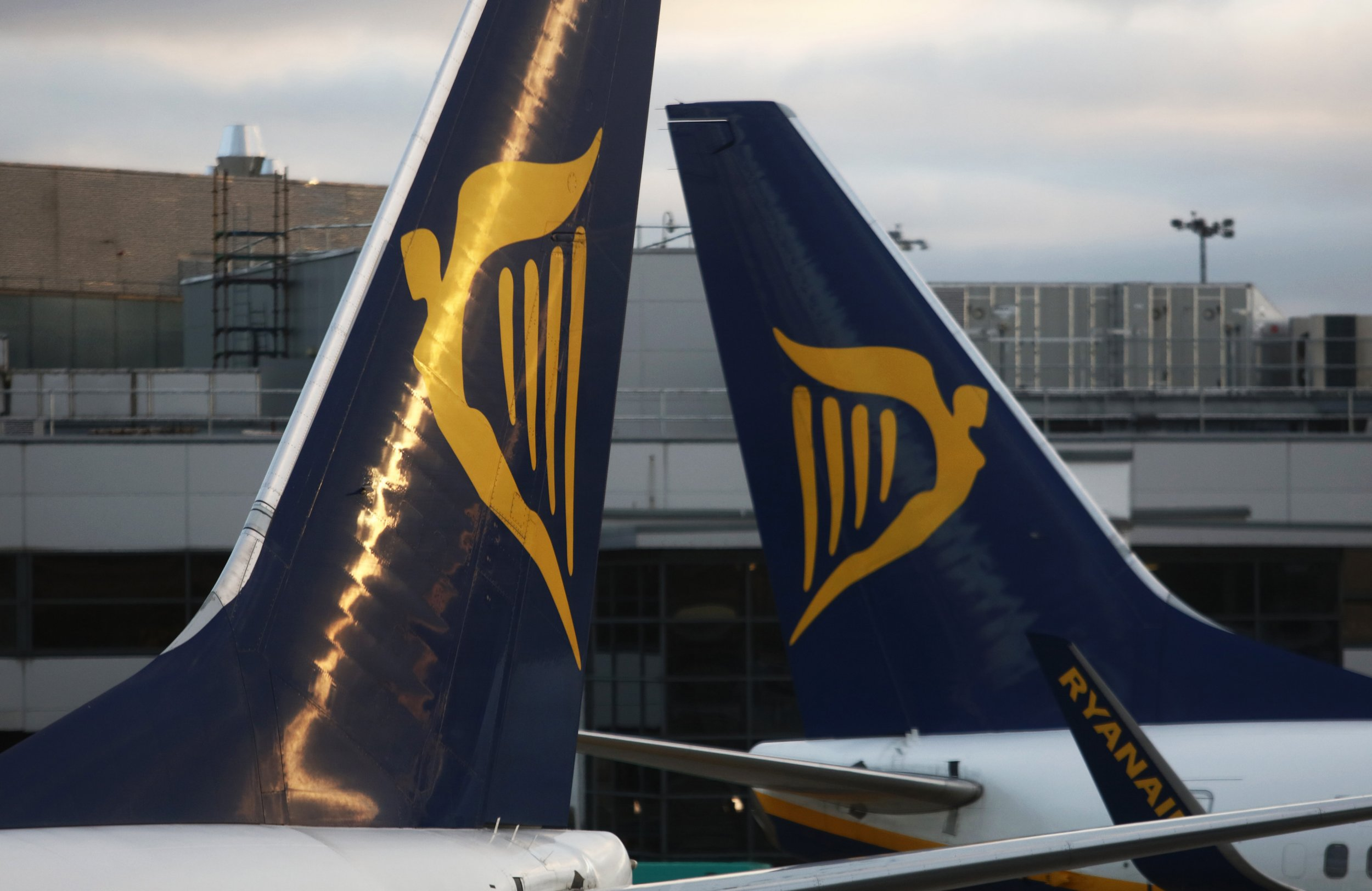 Tail fins of Ryanair Holdings Plc aircraft stand next to each other at Dublin Airport, operated by Dublin Airport Authority, in Dublin, Ireland, on Friday, Nov. 25, 2016. Ryanair provides low fare passenger airline services to destinations in Europe. Photographer: Chris Ratcliffe/Bloomberg via Getty Images