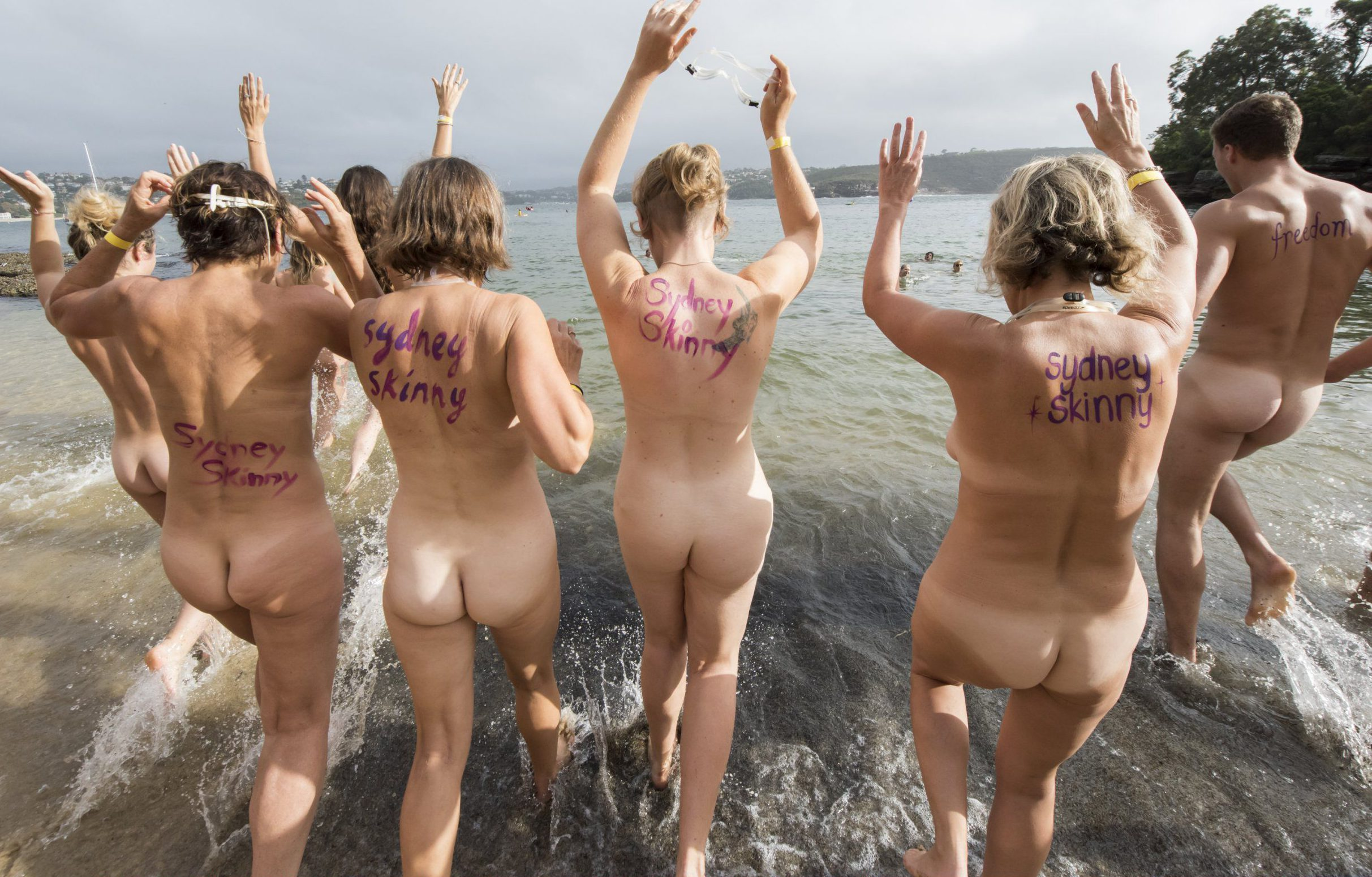 "SYDNEY, AUSTRALIA - MARCH 19: (EDITORS NOTE: Image contains nudity.) Swimmers taking part in the ""Sydney Skinny"" on March 19, 2017 in Sydney, Australia. The annual nude swim event encourages swimmers to raise money for a number of Australian charities and good causes. (Photo by James D. Morgan/Getty Images)"