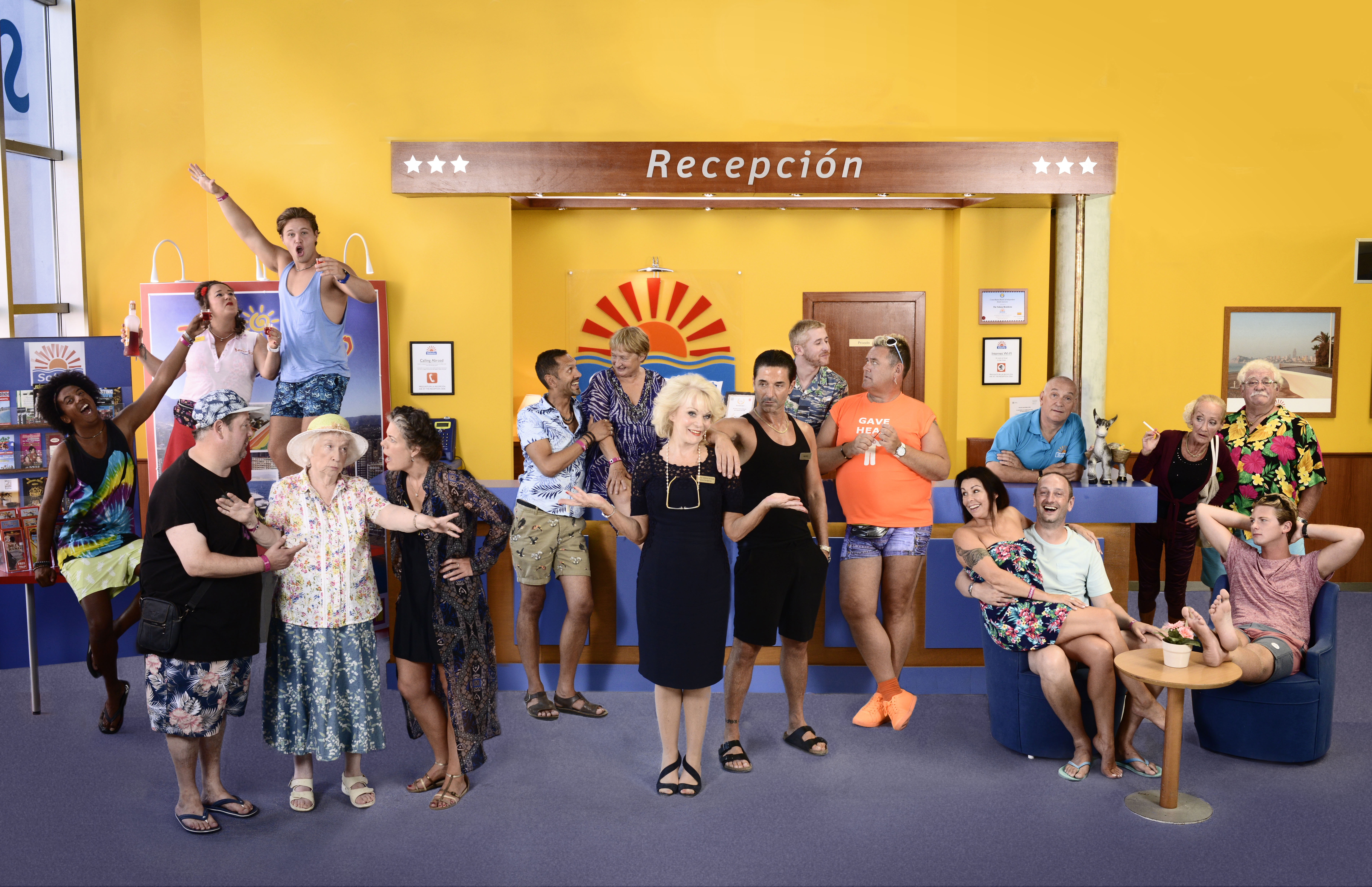 From Tiger Aspect Productions Benidorm: SR9: Ep1 on ITV Pictured: Back row: Joey [Nathan Bryon], Sam [Shelley Longworth], Tiger [Danny Walters], Troy [Paul Bazely], Jacqueline [Janine Duvitski], Liam [Adam Gillen], Kenneth [Tony Maudsley], Neville [Simon Greenall], Loretta [Kate Fitzgerald] and Eddie [Bobby Knutt]. Front row: Geoff [Johnny Vegas], Noreen [Elsie Kelly], Pauline [Selina Griffiths], Joyce [Sherrie Hewson], Mateo [Jake Canuso], Sheron [Julie Graham], Billy [Steve Edge] and Rob [Josh Bolt]. This photograph is (C) Tiger Aspect Productions and can only be reproduced for editorial purposes directly in connection with the programme or event mentioned above. Once made available by ITV plc Picture Desk, this photograph can be reproduced once only up until the transmission [TX] date and no reproduction fee will be charged. Any subsequent usage may incur a fee. This photograph must not be manipulated [excluding basic cropping] in a manner which alters the visual appearance of the person photographed deemed detrimental or inappropriate by ITV plc Picture Desk. This photograph must not be syndicated to any other company, publication or website, or permanently archived, without the express written permission of ITV Plc Picture Desk. Full Terms and conditions are available on the website www.itvpictures.com For further information please contact: james.hilder@itv.com / 0207 157 3052