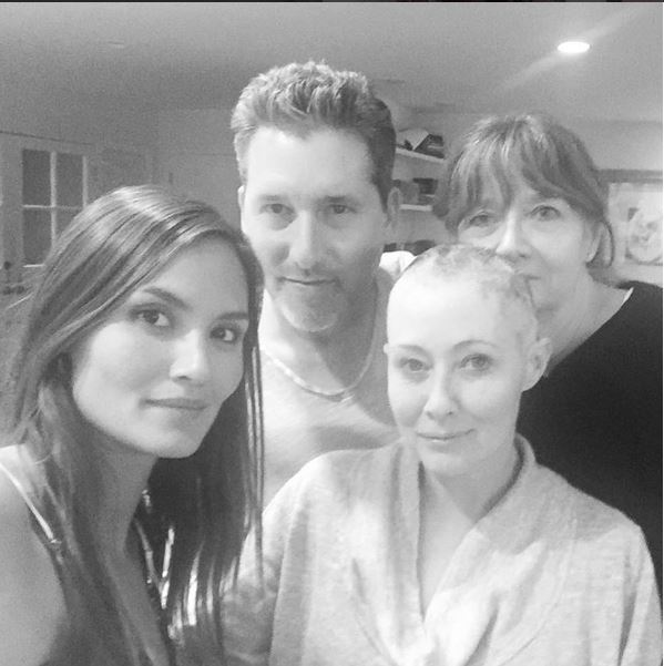 Shannen Doherty 'laughing thru the tears' as she shaves hair amidst cancer battle