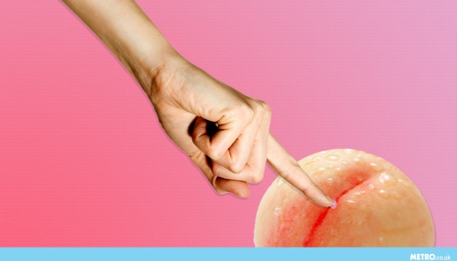 Woman's hand sticking a finger in a peach