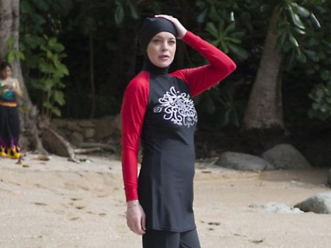 Lindsay Lohan sports a burkini on the beach as she holidays in Thailand