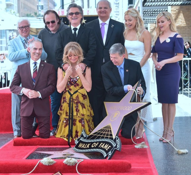 Kurt Russell (C-top) and Goldie Hawn (C-bottom) react during their Walk of Fame Stars ceremony in Hollywood, California, on May 4, 2017 as actresses Kate Hudson (2nd R) and Reese Witherspoon (R) and director Quentin Tarantino (2nd L) look on