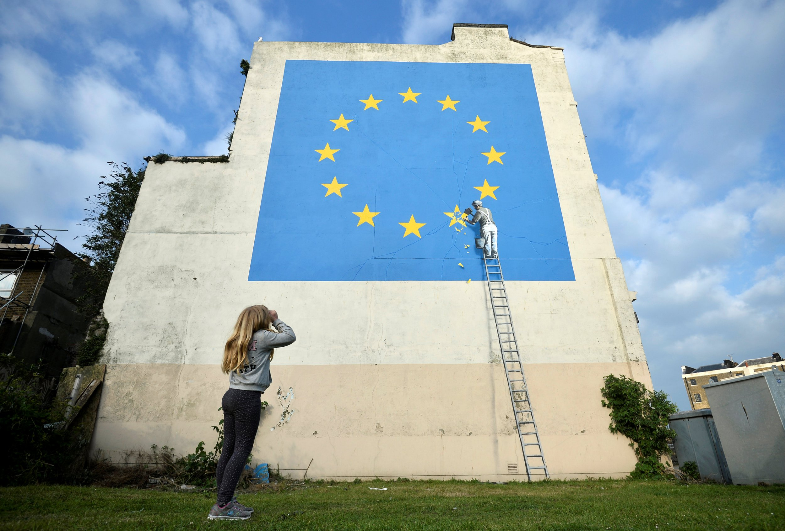 New Banksy piece shows workman chipping away at star on EU flag