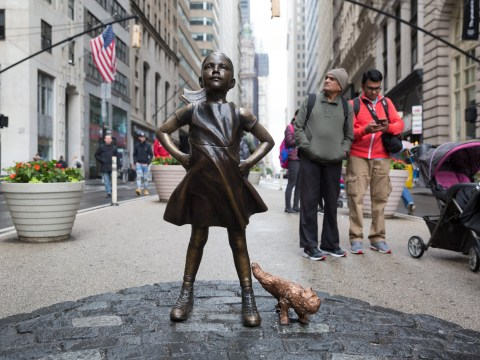 People are annoyed about a peeing dog statue being erected by Fearless Girl