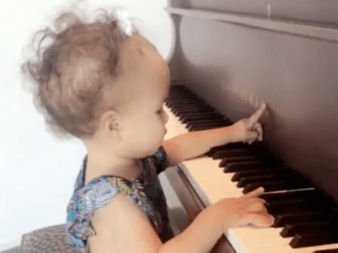 John Legend's one-year-old daughter is playing the piano and basically putting you to shame