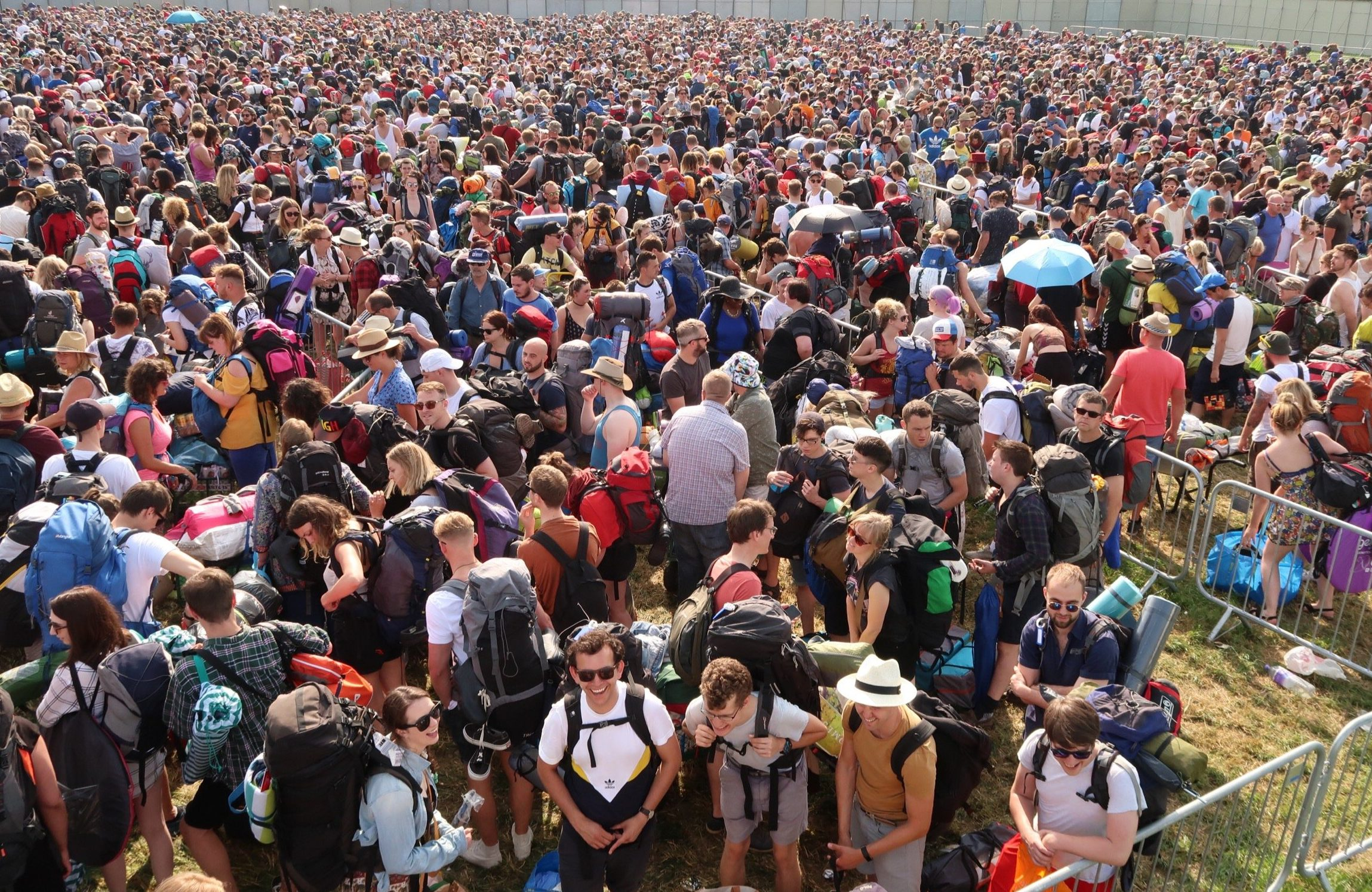 Look at these queues to get into Glastonbury and be glad you're sat at your desk for once