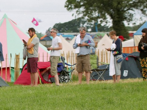 Ed Balls joins us mere mortals as he queues for the showers at Glastonbury