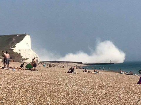 Major search operation launched after '50,000 tonnes of chalk' breaks off cliff on UK beach