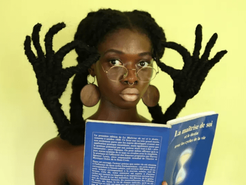 Artist celebrates natural Afro hair by sculpting her own into amazing hand gestures