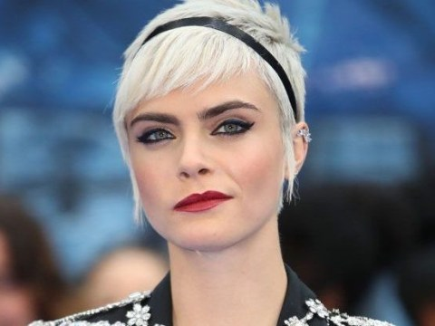 Cara Delevingne dons a suit for video of debut single I Feel Everything