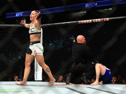 Cris Cyborg ends long wait for UFC title with knee stoppage victory over Tonya Evinger