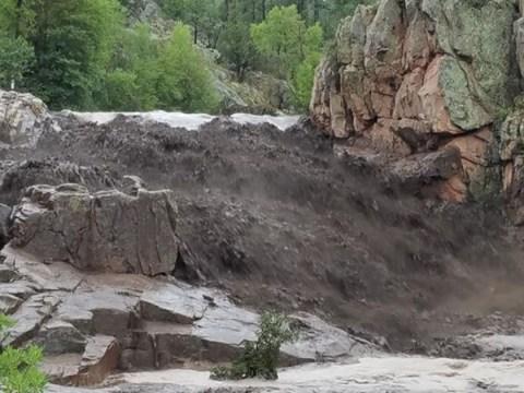 Five children dead after flash flooding hits swim hole