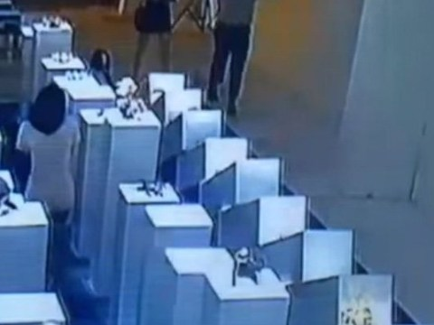 Clumsy woman appears to destroy $200,000 worth of art with ill-fated selfie