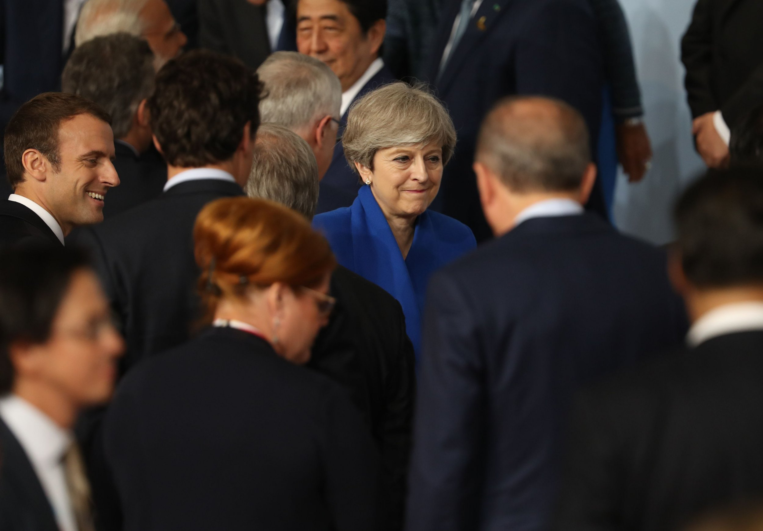 Theresa May will be prime minister at least another year, she tells G20 leaders