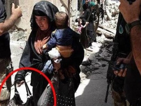 Female suicide bomber pictured holding baby moments before detonating bomb