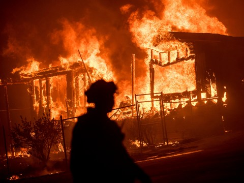 Firefighters injured and thousands evacuated as inferno tears through California